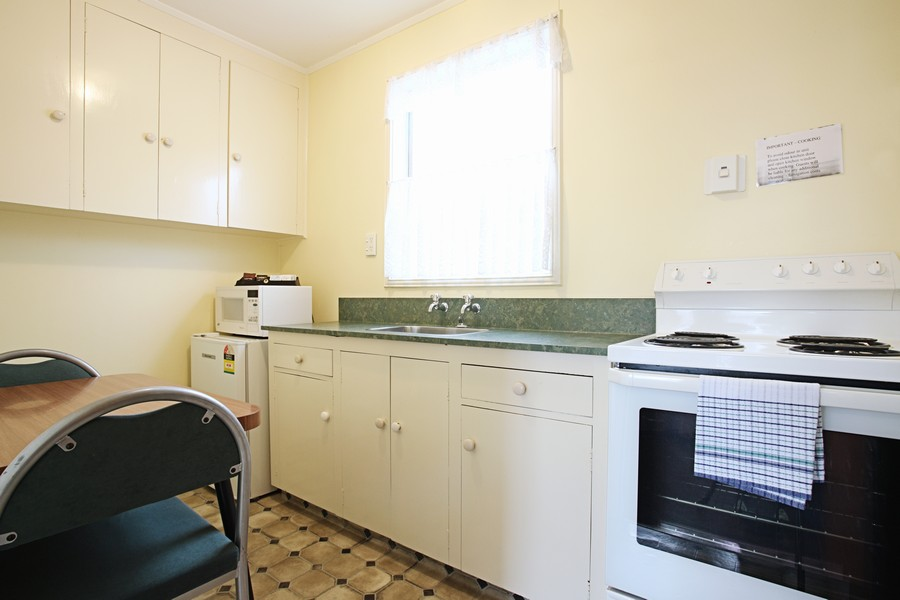 Full kitchen with stove