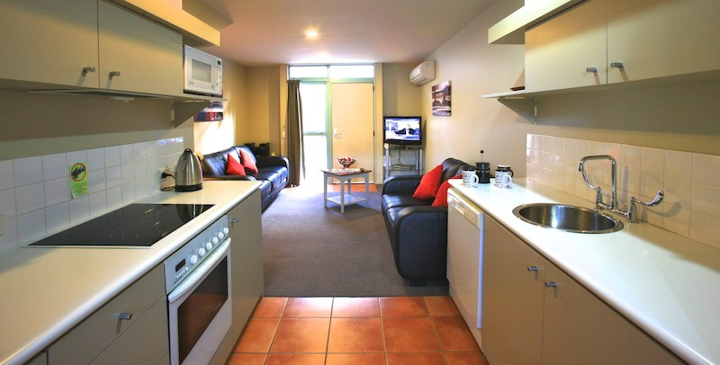 Fully equipped kitchen including Oven, Microwave, Refrigerator, Dishwasher, and complimentary tea and coffee
