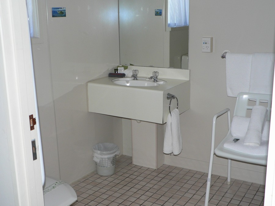 Bathroom with shower chair
